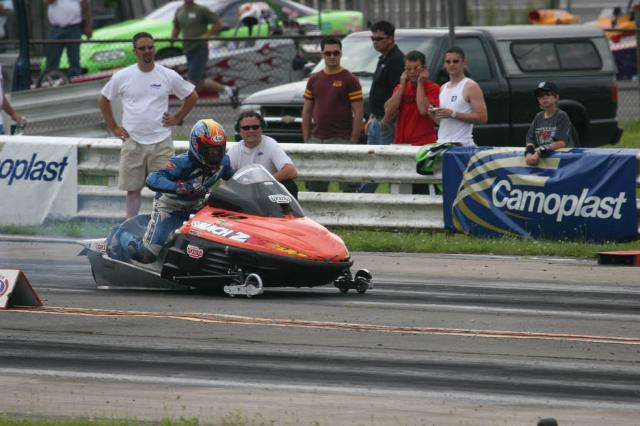 people watching a person drive his powersports vehicle