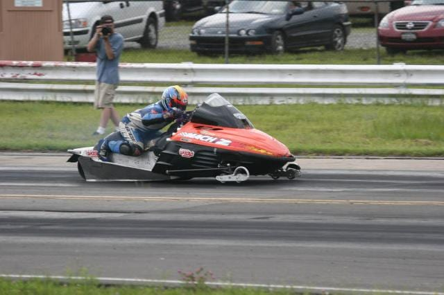 a person driving a powersports vehicle 6