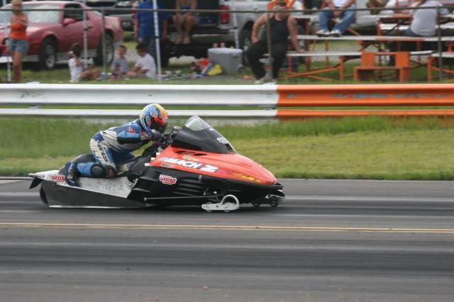 a person driving a powersports vehicle 7