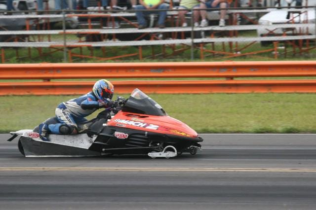 a person driving a powersports vehicle 8