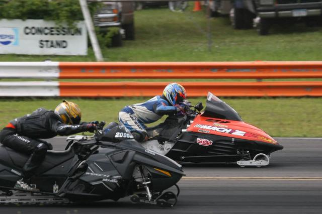two people driving motor vehicles racing against one another