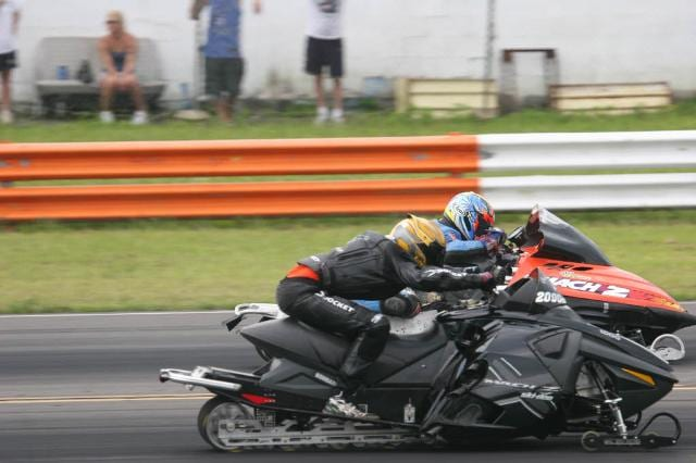 two people driving motor vehicles racing against one another 2